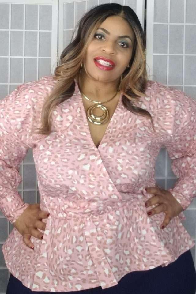 Plus size Eloquii pink leopard peplum blouse.